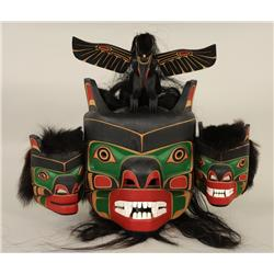 Salish Bear Mask Carved with a Raven Finial by Derald and Ryan Scoular 29  W. 23  H.  Fine Condition