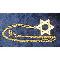 501. 14K Gold Jewish Star weighing 2 Grams on a unmarked Chain.