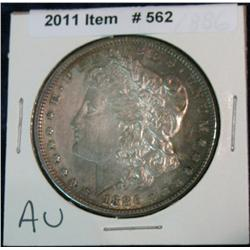 562. 1886 P Morgan Silver Dollar. Toned AU.
