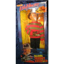 673.Talking Freddy Kreuger doll in original box with