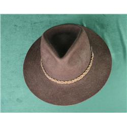 Orvis Bison cowboy hat with leather band and  wood stand in overall very good condition.    Est.:  $