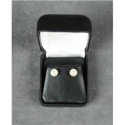 Pearl Earrings approx. 8mm set in 14kt yellow  gold. Est. $40-$80