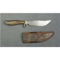 "Mexican belt knife and leather sheath approx.  12"" overall with an approx. 7"" semi-clip  point blade"