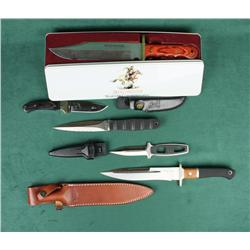 Lot of five modern knives in factory  cardboard boxes including a Winchester  Commemorative Model 94