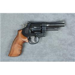 "Smith & Wesson Model 24-3 DA revolver, .44  Special cal., 4"" barrel, blue finish, custom  checkered"
