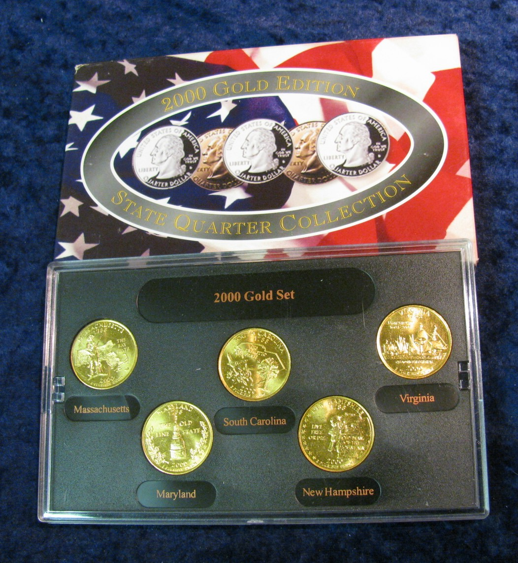 25. 2001 gold edition state quarter collection in special holder and.