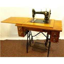 Antique White brand treadle sewing machine