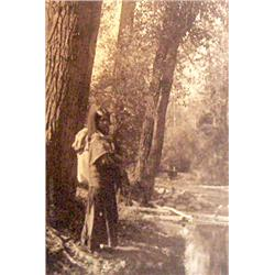"McKay, Rollin H. (1880-1965),  Indian Woman by Creek, photo,  6"" x 4 ¼"", gelatin silver sepia toned."