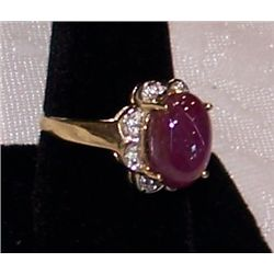 14K Yellow Gold Ring set with a Ruby Cabochon and Diamonds..