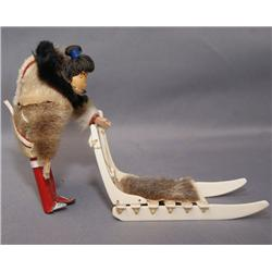 NORTHWEST COAST DOLL AND SLED