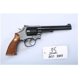 "Smith & Wesson model 48-4 double action  revolver, 4"" barrel in .22 long rifle with  extra fitted cy"