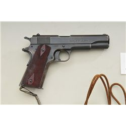 Colt model 1911.45 automatic, US military  issue, serial #322423. Left side of the frame  shows eagl