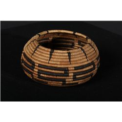 "Finely woven Pomo basket, approx. 4-1/2""  across center, nearly 2"" deep, bowl shape.  Good pattern,"