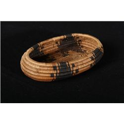 "Fine Pomo basket with very tight weave,  measures nearly 5"" across center, nearly 1""  deep. Some sla"