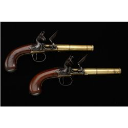 Pair of English Georgian era flintlock  pistols with brass frames and turned canon  barrels. Signed