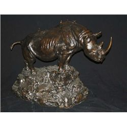 "Large bronze of African black rhino measuring  approx. 30"" in height by 45-1/2"" from end to  end. Ba"