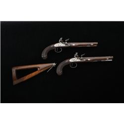 "Pair of flintlock officer's type pistols  signed ""H. W. Mortimer London  Gun Maker to  His Majesty"""