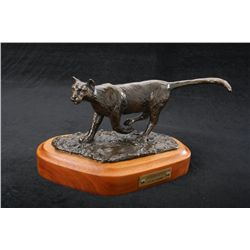 Original bronze by Carl Wagner entitled Deer  Hunter showing cougar, numbered 7 of only 10,  dated 1