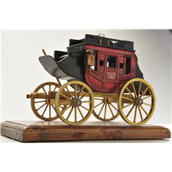 "Hand-carved wood model of Wells Fargo  stagecoach by Oscar M. Cortes, 1978 dated.  Approx. 6""h by 10"