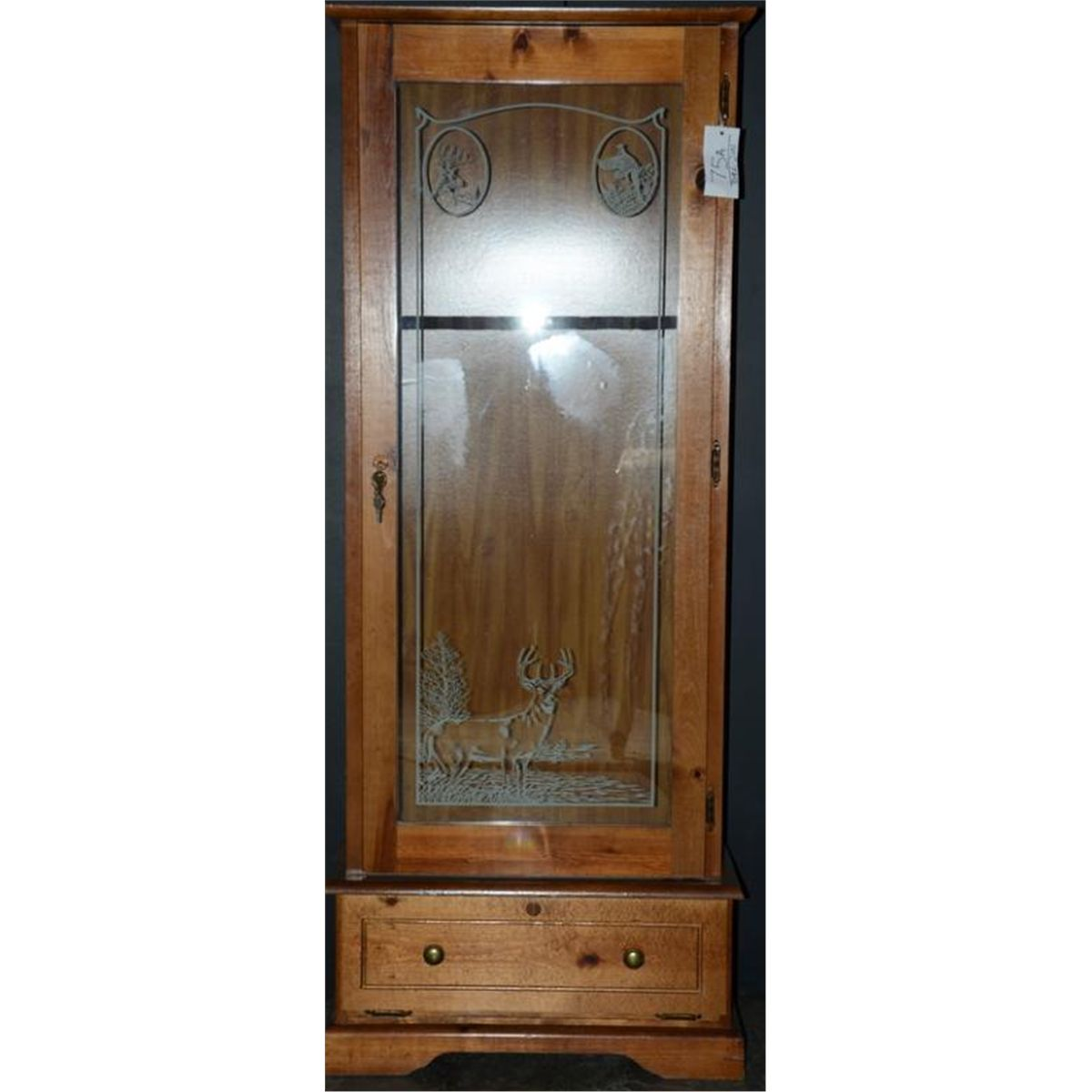 Beautiful long arm gun cabinet made of wood and with a glass front ...