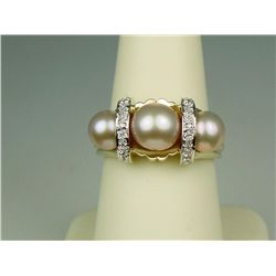 Very fine 14 karat yellow gold ladies  contemporary design ring set with three round  peach color pe