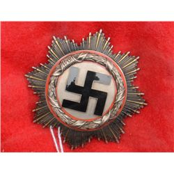 Excellent German Cross in silver with black  enameled swastika, red enameled trim under  silver wrea
