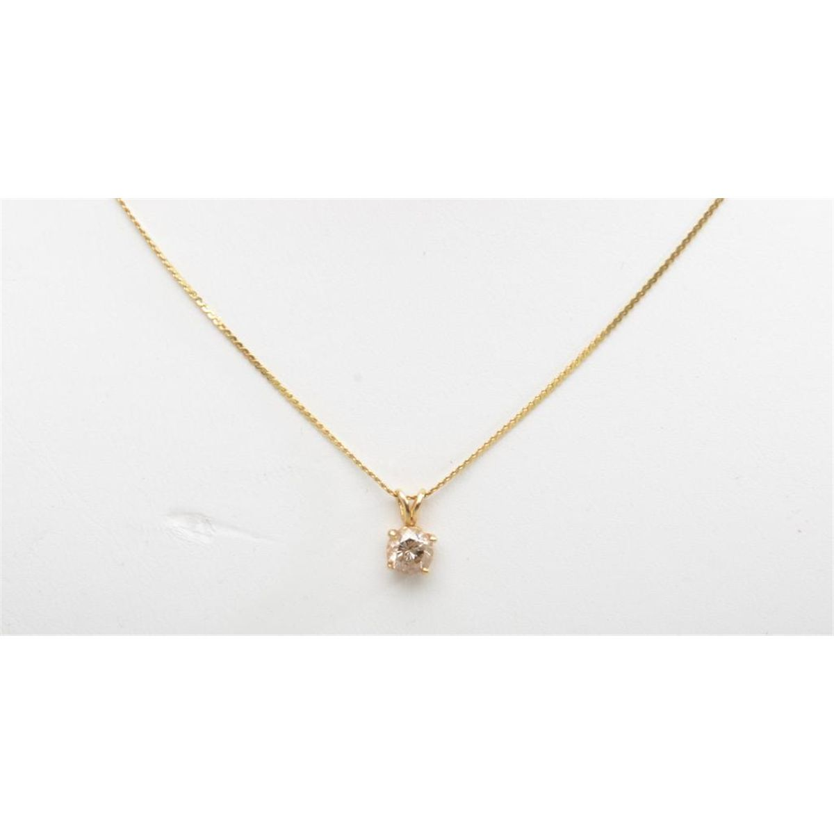 Diamond Pendant on gold chain. Modern design. Est.: $100-$200.