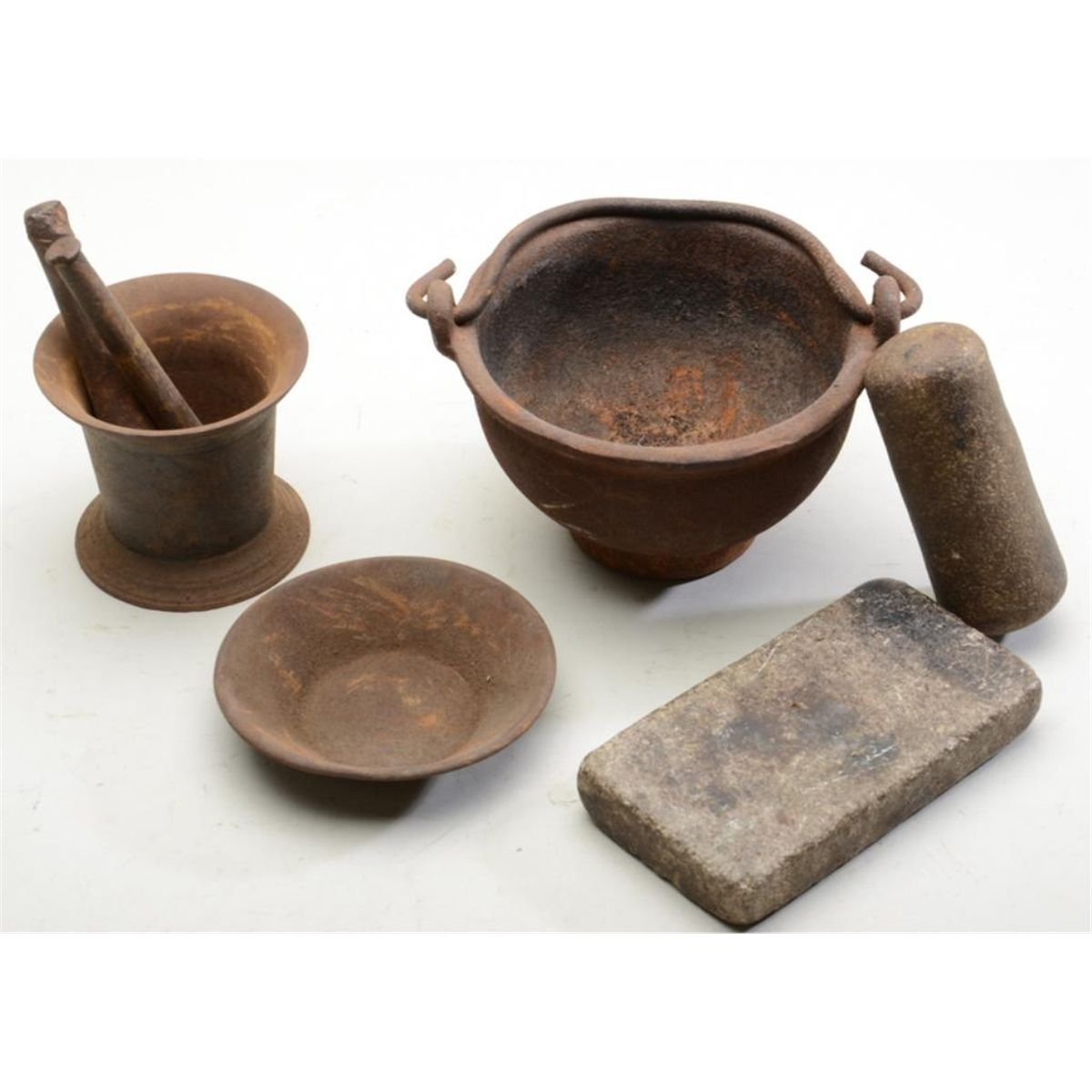 Lot of old utensils including a small old iron pot, small plate, a ...