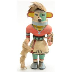 "Older wooden Kachina doll in overall very  good condition, bright colors and approx. 12""  in height."