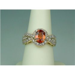 Exquisite 14 karat yellow gold ladies custom  made ring set with a very fine intense orange  sapphir