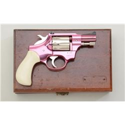 "High Standard Model R-101 DA revolver in  factory wood case, .22 cal., 2-1/2"" barrel,  pink anodized"