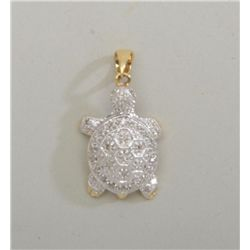 Turtle shaped pendant with 0.20ct and 14kt  white gold. Est: $500 - $750