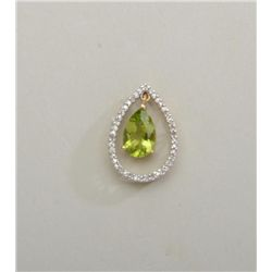 Pear shaped pendant set with diamonds and  dangling peridot. Est: $350 - $500