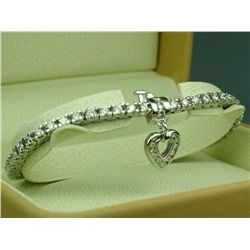 Exquisite 14 karat heavy white gold ladies  diamond tennis bracelet set with 58 fine  round brillian