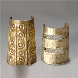 two ancient andean wrist guards or cuffs