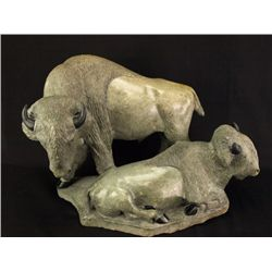 Carved stone buffalo bull and cow grouping