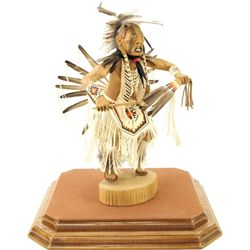 Hand carved Kachina with full feather and leather
