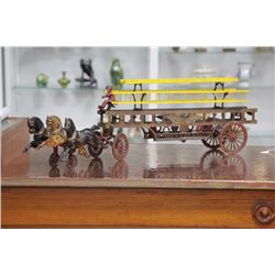 HUBLEY HORSE DRAWN FIRE TRUCK. Cast iron with three horses, driver, three wooden ladders and truck w