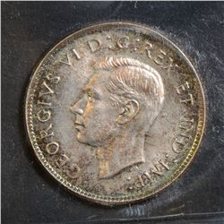 1946 25 Cents, ICCS MS-65. Toned.