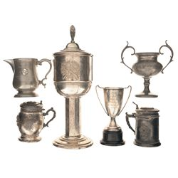 Four Shooting Trophies and Two Shooting Themed Lidded Mugs