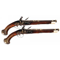 Pair of Elaborate Gold Accented and Silver Furnished 18th Century Flintlock Pistols