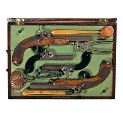 Unique Cased Garniture of Two Pairs of European Percussion Pistols with Accessories