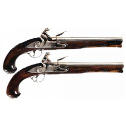 Attractive Brace of Silver Finished S. Coddington Marked English Flintlock Pistols