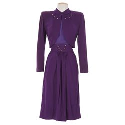 Claudette Colbert purple suit designed by Adrian from Without Reservations