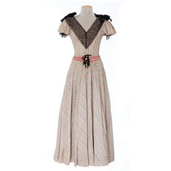 Vanessa Brown multi-colored striped period dress from The Foxes of Harrow