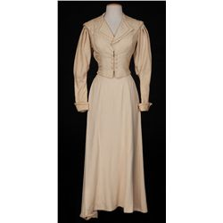 Susan Hayward beige raw silk jacket & long skirt designed by Dorothy Jeakins from White Witch Doctor