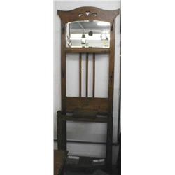 A c1900's oak hall stand with bevel edge mirror to top and a glove box