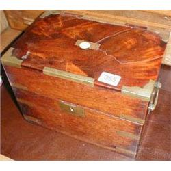 A C19th flame mahogany military box with brass fittings and five compartments to interior and drop b