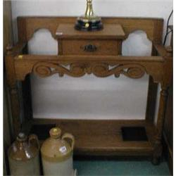 A c1900 oak hall stand with carved front and glove drawer