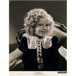 Shirley Temple collection of (8) portrait and scene stills, including one stamped by George Hurrell